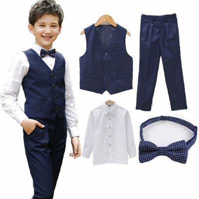 Комплект одежды для мальчика - жилет, брюки, рубашка, галстук-бабочка.